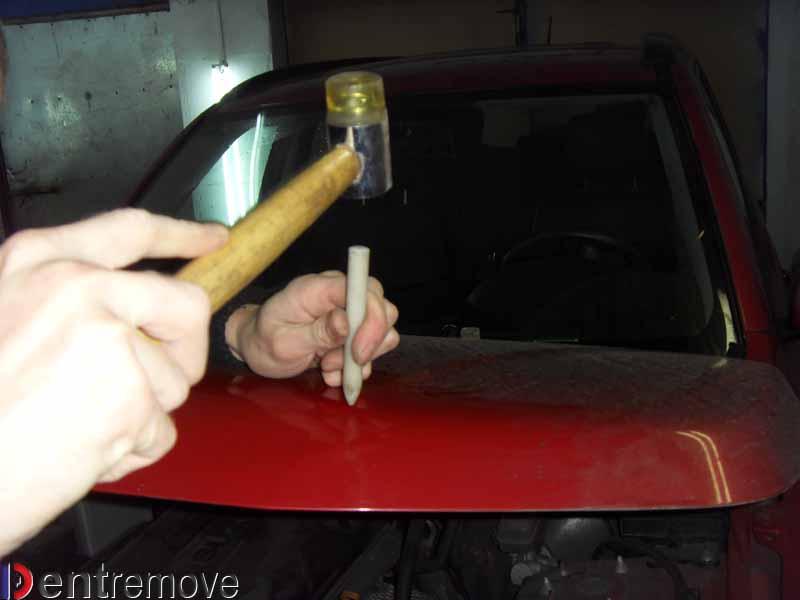 Беcпокрасочный ремонт вмятины на Suzuki